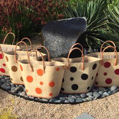 Polka dot straw bags from Madagascar.  By Shebobo