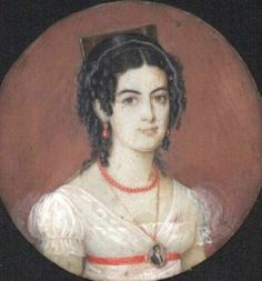 Portrait miniature of a Chilean woman wearing a portrait miniature necklace and coral