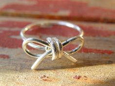 sterling silver bow wire ring in your size by DrVintage, $33.00....i want!