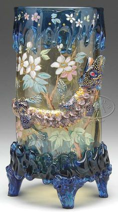 A Moser glass vase having light amber body and applied blue glass rim, rigaree at the foot, large applied glass lizard or komodo drag...| JV