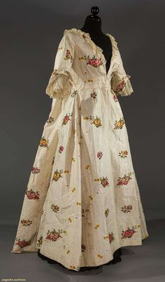 SILK BROCADE SACK BACK GOWN, 18TH C Lot: 2102 May 11, 2016 - Sturbridge, MA  Ivory patterned silk brocaded w/ polychrome flowers, significant 19th-20th century alterations, few small holes, silk fabric is exc