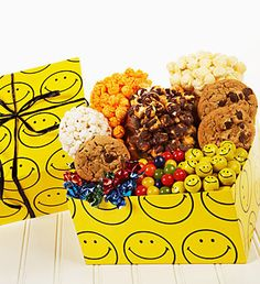 Smiley Face Sampler Box- Sour Fruit Chew, Drizzled Caramel Corn Popcorn, Chocolate Chunk Cookies  Smiley Face Foil Wrapped Milk Chocolates, Popcorn Ball, The Popcorn Factory® Cheese Popcorn and more $20.00