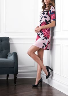 The blooming floral rose detail on this pretty pink shift dress makes it so feminine and romantic.