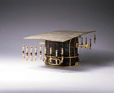 he crown is mainly made of wood and pine strips It is decorated with colorful jade beads on nine lines. This crown was made according to the rank of Duke in Ming institutions. It is an important object. History of the Object The grave of Lu Zhu Tan (1370-1389) was discovered in 1970. Zhu Tan belonged to the Imperial Family for the early Ming Dynasty; he was the tenth son of Emperor Hongwu, founder of the Ming dynasty. More than 2000 objects were found at the grave site.