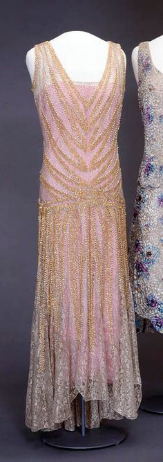 Dress, Blancquaert, 1929. Machine- and hand-sewn blond lace and embroidered with metal thread & strands of pearls and glass beads. Underdress of machine-woven silk. National Museum for Art, Architecture, & Design, Norway