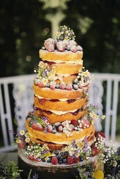 rustic naked mixed berry wedding cake / http://www.deerpearlflowers.com/rustic-berry-wedding-cakes/