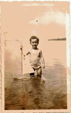 Antique Vintage Photograph Little Baby Boy With Sailboat in Lake