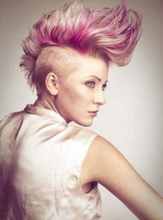 Bold mohawk with pink streaks. on The Fashion Time  http://thefashiontime.com/20-spectacular-mohawk-hairstyles-hair-length/#sg16