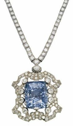A SAPPHIRE AND DIAMOND NECKLACE/BROOCH   The detachable pendant/brooch centering upon a cushion-shaped sapphire, weighing approximately 86.03 carats, in an openwork diamond set surround, to an associated diamond-line neckchain, 1930s, chain 39.5 cm  Necklace signed Petochi