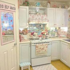 Shabby Pink Kitchen! Love the mirror and vent cover! And the trivet sitting pretty upon the backsplash ledge!