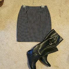 Black and white check skirt Cute skirt...pair it with boots and leggings now and flats or sandals later! Runs small...fits more like a 6. Andrea jovine Skirts Pencil