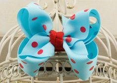 Handcrafted Polka Dot Boutique Bow.  Ocean blue hair bow with  red dots.