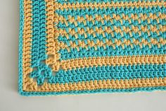 Pair yellow and blue together to make a rug that will brighten any room in a subtle, warm way. This rug is great in the kitchen, by your front door, and any room in your home.