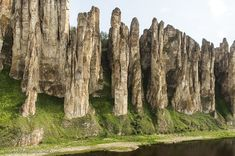 The Lena pillars are a natural rock formation along the banks of the Lena River in far eastern Siberia. The pillars themselves are made of alternating bands of limestone, marlstones (calcium carbonate or lime-rich mud or mudstone which contains variable amounts of clays and silt), dolomite and slate of the Lower/Middle Cambrian. They were once the bottom of an ancient sea. Consequently the place is littered with fossils. The magnificent stone pillars are 150-300m (490-985ft) high.