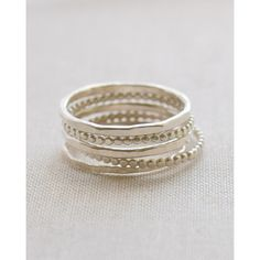 Beaded Stacked Rings Set ($51) ❤ liked on Polyvore featuring jewelry, rings, hammered sterling silver jewelry, sterling silver jewellery, beaded jewelry, beaded rings and beading jewelry
