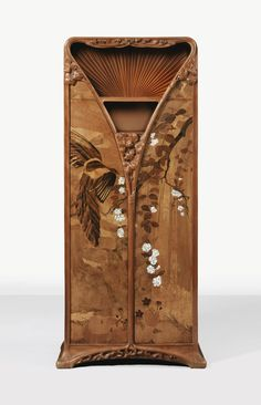 Louis Majorelle LA CASCADE CABINET, 1898 carved Honduran mahogany, amaranth, marquetry of walnut, oak, Rio rosewood and beech and mother-of-pearl Signed L. Majorelle and dated 1898 on the base