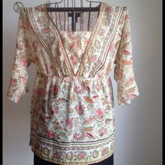 Tunic style Top Show a little flare in this top. Lightweight light green base color. Great condition. Ties in back. Very flowy not much stretch. Touches of gold in pattern. Tops Tunics