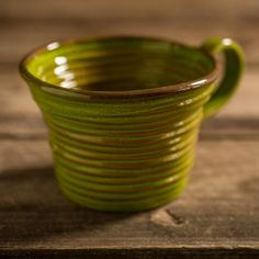 Coiled 'Colombino' mug in autumnal forest green glaze. Artisanal rustic design, handmade by italian craftsmen.