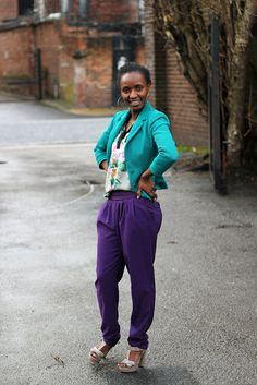 Purple harem pants and floral blouse and green blazer