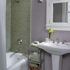 White and Lavender bathroom boasts a white trellis mirror, lining a on fuschia bathroom designs, mahogany bathroom designs, white on white bathroom designs, dragon bathroom designs, hot pink bathroom designs, mauve bathroom designs, sage bathroom designs, light green bathroom designs, black bathroom designs, relaxing spa bathroom designs, blue and yellow bathroom designs, dark wood bathroom designs, hunter green bathroom designs, light yellow bathroom designs, lavender storage, magnolia bathroom designs, lavender decor, chocolate bathroom designs, navy bathroom designs, grey bathroom designs,