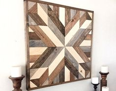 This beautiful hand crafted wall piece is just the thing you need to add that special touch of charm to your home. It is made from reclaimed wood and sourced from local farms. Dimensions: -- the pictured piece is approximately 32 x 32 -- also available in 36 x 36 Check out some of our other favorite pieces here: https://www.etsy.com/listing/513634814/reclaimed-wood-wall-art-rustic-wall-art https://www.etsy.com/listing/509630660/reclaimed-wood...