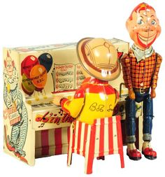 April 19 & 20 Auction. Tin Litho Unique Art Howdy Doody Wind-Up Toy. American. Working. Depicts Howdy Doody dancing and Bob Smith playing the piano. Tin lithography also depicts the peanut gallery on back and several other Unique Art toys that were available at the same time. #UniqueArt #HowdyDoody #Toys #MorphyAuctions