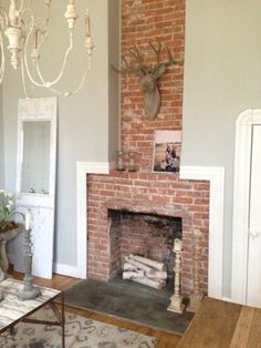 sherwin williams silver strand is a subtle blue gray colour with just a dob of green to soften it. Shown with red brick fireplace