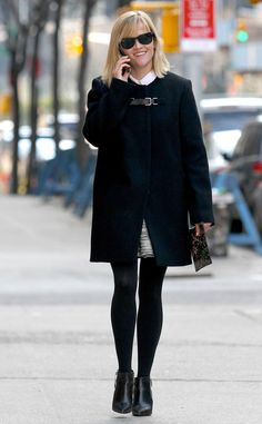 Reese's Pieces from Celebrity Street Style  The Oscar winner bundled up in dark coat and black tights while out and about in Manhattan in New York City.