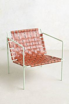 Looks Like you could DIY with Pipe & Leather strips Rod & Weave Chair