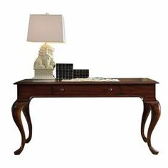 """An elegant addition to your living room or home office, this 1-drawer writing desk showcases mahogany veneers and cabriole legs.  Product: DeskConstruction Material: Poplar solids with mahogany and swirl walnut veneerColor: Dark brownFeatures:  One drawerDrop-fton keyboard trayCabriole legs Dimensions: 30.5"""" H x 60"""" W x 30"""" D"""