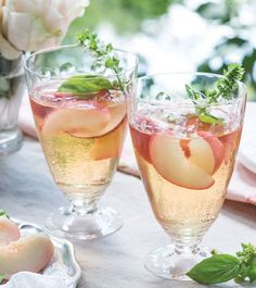 White Peach Sangria is a refreshing blend of Peach-Basil Syrup, Pinot Grigio, grape juice, brandy, and peaches. Peach Sangria Recipes, White Peach Sangria, Peach Bellini, Fresco, Smoothie, Victoria Magazine, Party Fiesta, Grape Juice, Just Peachy