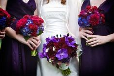 Brides Bouquet: Purple Vanda Orchids, Black Magic Roses, Monkey Tails.  BridesMaids Bouquets: Dark Red Gerbera Daisys and Dark Blue Hydrangea,