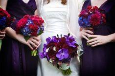 Brides Bouquet: Purple Vanda Orchids, Black Magic Roses, Monkey Tails.  BridesMaids Bouquets: Dark Red Gerbera Daisys and Dark Blue Hydrangea,