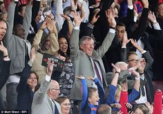 Sir Alex Ferguson and Sir Bobby Charlton join in a Mexican wave at the Legends game v Real Madrid