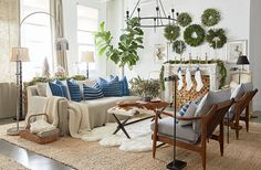 Even a few small additions can make your home feel ready for the holidays. Try bringing in cozy accents like a sheepskin rug and knit throws to warm up a relaxed blue-and-white space and give a nod to the season.