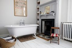 A fireplace next to a claw foot bathtub? YES PLEASE! This may just be my dream.