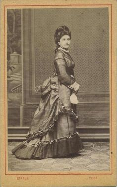 Sheer 1870s bustle dress! You can see her corset cover!