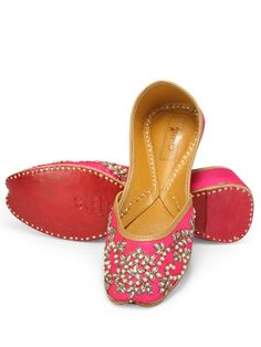 Rani pink jutti with kundan embelishments. The silk jutti has satin lining and is made of soft genuine leather.Designer juttis by Coral Haze | Shop on www.jivaana.com for all your Indian weddings and festivals. #jivaana #juttis #jootis