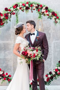 We're all about the beauty of blush affair any day of the week, but rustic fall wedding inspiration with pops of reds and shades of plum sing to our hearts.