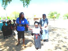 Sr. Gertraud Kahili, OSB is the Principal of St. Scholastica Kindergarten in Namuntuntu, belonging to the Missionary Benedictine Sisters of Tutzing, Windhoek Priory. This photo was taken during the Graduation in November 2013. Sr. Gertraud is assisted by the lay teacher of the Kindergarten.