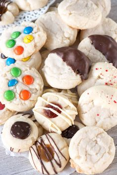 Soft chewy shortbread cookies from one shortbread recipe, with 4 recipe variations. Add M&Ms, dip them in chocolate, or make shortbread thumbprint cookies!