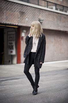 Black pants black boots white light pink shirt black gray sweater