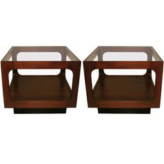 Pair of side tables by Jonh Keal for Brown Saltman. They are made of walnut with a glass top and a black stained base.