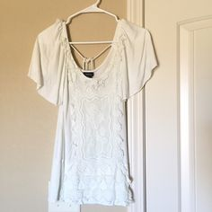 Cream Lace Top An Anthropologie look alike. It's super soft because it's 100% rayon. There are a few things that makes this piece unique; the beautiful lace stitched on the front, the loose arms adding a unique touch and the string that goes straight across the upper back. Rue 21 Tops Tees - Short Sleeve