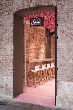 Ideo Arquitectura hangs 12,000 wooden pink sticks from the ceiling of Madrid's patisserie shop