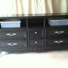 Repurposed dresser into an entertainment center...