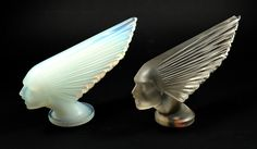 Interesting comparison shot showing the now discontinued opalescent Victoire paperweight   from Crystal lalique, with my perfect original R,Lalique Victoire car mascot   .