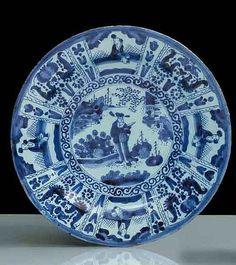 Delft Plat rond à décor en camaïeu bleu dans le style des porcelaines chinoises Wanli fin 17e s 34 cm