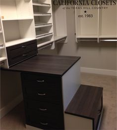 Two-toned closet with integrated a #custom peninsula with a bench. Love it! #design #Austin