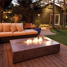 Nearly five and a half feet long, Brown Jordan's Flo fire pit offers an elegant centerpiece ideal for pairing with sectionals. The sleek design is crafted from composite concrete materials, ensuring it can withstand the elements. It features extra wide edges, providing a tabletop surface. The base is constructed with height-adjustable articulating feet to allow